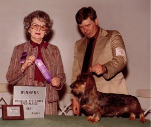CH Rose Farm's Rough and Ready W ith Judge Barbara Lovering and owner Dan Harrison for co-owners Asa and Karen Mays. He was the best of the three Timber/Moonbow puppies we got
