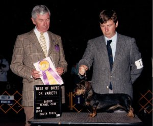 CH Boondox Nifty Ned MW, Judge James Clark and handler Dan Harrison for owner